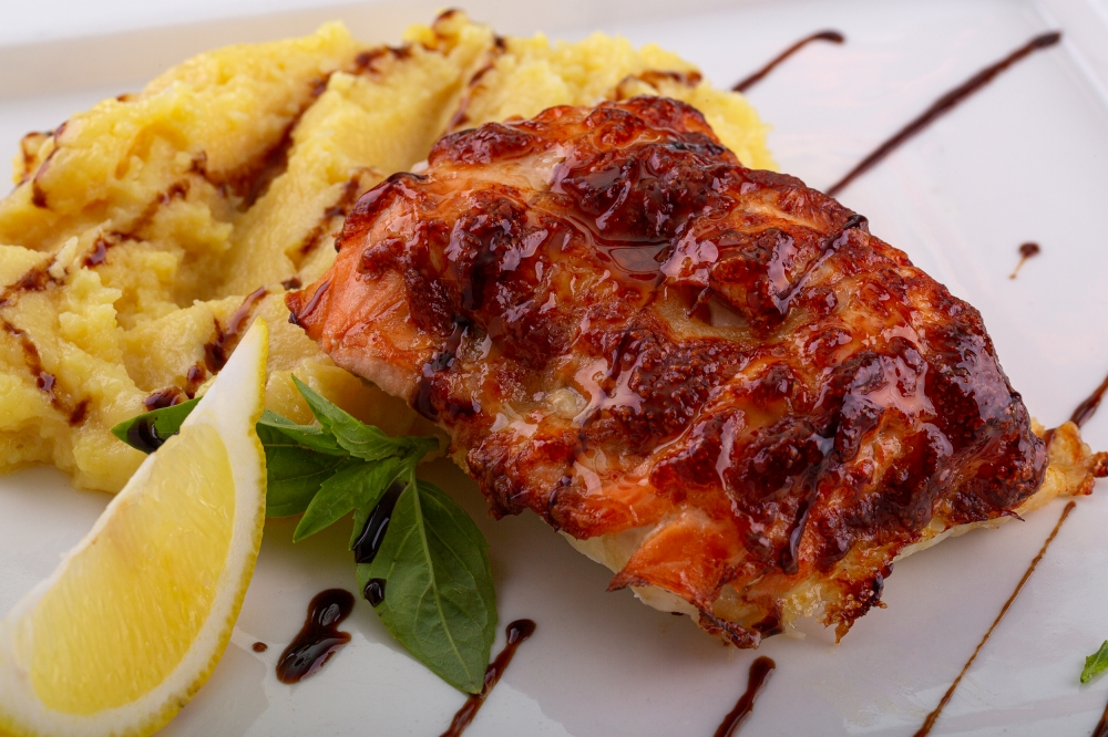 Two kinds of fish (cod and salmon) with mashed potato